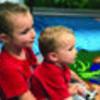 Caitlynn Feldkamp holds young cousin, Christopher Feldkamp while listening to story.