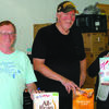 Jerry Prather, Glenn Miller and Skye Curnette are just some of the many volunteers who help each month to help feed local residents