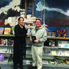 Dr. Alissa Burger presents the Plein Air Poetry blue ribbon to Dr. Patrick Lane for his poem Signs of Life at the Canton Public Library on October 12.