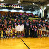The Highland Cougars and Highland Lady Cougars presented a check to Sarah Degarmo and family during pink night at Highland on Feb.7.
