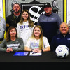 Smith-Cotton High School senior Megan Toops has signed a letter of intent to play soccer at State Fair Community College in Sedalia. Seated with her are her parents, Kim and Rob Toops; back, from left: S-C Principal Wade Norton, S-C Girls Soccer Assistant Coach Ethan Weller, sister Sydney Toops, SFCC Women's Soccer Head Coach Jaime Beltran, and S-C Girls Soccer Head Coach Meredith Brick. (Courtesy of Sedalia School District 200)
