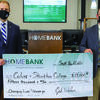Dr. Douglas B. Palmer, left, president of Culver-Stockton College, and Josh Wilson, community bank president of HOMEBANK's Northeast Missouri market, hold a check for $15,000 that will be used toward the construction of the Student Experience Center at Culver-Stockton College.