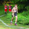 Gage Rudd working his way up a hill at the Palmyra Invitational.