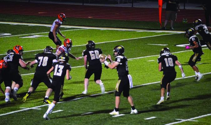 Drew Mallett #15 getting ready to hand the ball to Cameron Bringer #13. Also pictured is Blake Kaylor #63, Cole Lair #78, Toby O'Brien #68, Robert Goehl #18, Brandon Holder #81, and Devin Stutsman #23.