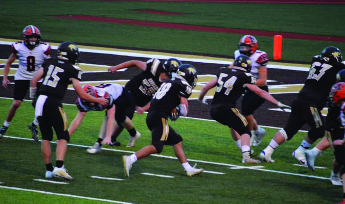 Robert Goehl #18 going for the score after receiving the ball from Drew Mallett #15. Also pictured is Aidan Lay #56, Will Harmon #54, and Blake Kaylor #63.