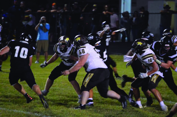 Cougars Toby O'Brien #68, Drasyn Keith #58, and Robert Goehl #18 playing defense against the Centralia team.