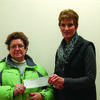 Nina Porter receives a check from Brenda Wright of Ursa Farmers Coop for the Lewis County Food Pantry in Canton.