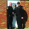 Lewis County Sheriff David Parrish congratulates Sergeant Jerrod Eisenberg on his promotion.