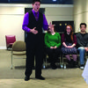 Matthew Froman, local champion, performing his poems at the regional competition.