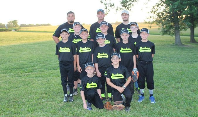 Members of the Perry Bombers baseball team are Coaches Shawn Moore, Mark Northcutt and Kyle Pociask. Back row from left are Dawson Talbott, Owen Totten, and Jack Pociask. Middle row from left are junior Alexander, Blake Moore, Colin Trower, Tyler Caldwell and Sam Northcutt. Front row are Colten Eisele and Thomas Barnes.