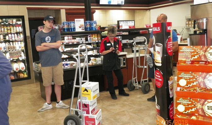 Store Manager Arlene Hudson is busy working with vendors to get merchandise stocked during Casey's Grand Opening on Friday, May 18, 2018.