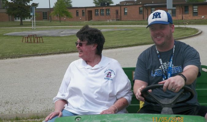 Mrs. P is driven around the track by Mr. Brandenburg, to open the MTJH Field Day events on May 11.