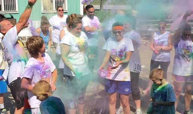 """Completion of the Center Color Run was celebrated with the throwing of the """"color""""."""