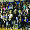 Student fans extended the Roar Zone and their enthusiasm is evident in their painted faces and excited leaps during the February 3 Courtwarming game against Van-Far.