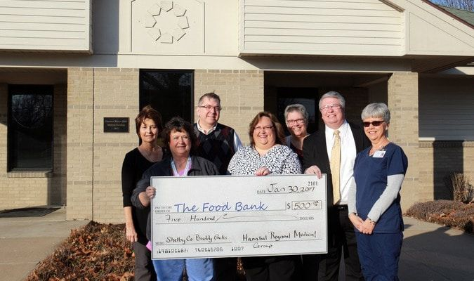 The Hannibal Regional Medical Group donated $500 to The Food Bank for Central and Northeast Missouri to support the Buddy Pack program in Shelby County. Pictured, front from left, are Dianne Kohn, Lyreva Clark, Steve Yager of The Food Bank, and Karen Simmons. Second row, from left, Kenna Rae Broughton, Dr. Michael Tentori and Traci Rich. For more information, visit www.sharefoodbringhope.org.