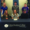 Katie Neff, senior at Mark Twain High School, signed a letter of intent to run Cross Country and Track & Field for Culver-Stockton College on Thursday, February 23. Pictured with Katie are her parents, Dawn and Tim Neff. Standing behind them are Erin Mack-Moss, MTHS Cross Country and Track coach, Alan King, C-SC coach, and Devin Neff, Katie's brother.