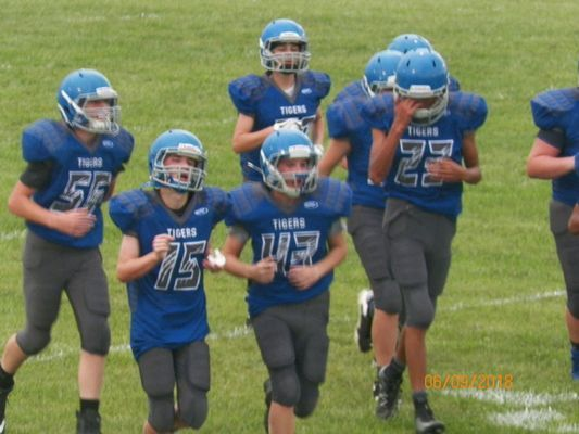 Jr High Tigers coming off the field:  #55 - Eli Oglesby; #15 - Lukas McLeod; #43 - Coleman Epperson; #23 - Dante Kelly.