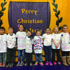 Students at Perry Christian Academy recently celebrated the 100th day of school.  Pictured are first grade students wearing their special 100th Day t-shirts.  Each student designed their own t-shirt with 100 different items or pictures.  Pictured are:  Jared Shuck, Tanner Eisele, Rhett Wise, Ella Totten, Ethan Brown, Madison Landis, Cami Smith, Avalynn Camden, Chloe Hodges, and Bailee Ward.