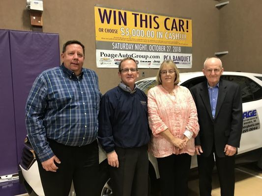 Congratulations to the PCA Grand Prize Winner, Penny Waller. She will receive a 2019 Chevrolet Equinox lease or $5,000 in cash from Poage Auto Group. Pictured left to right: Scott Johnson, Aaron Poage, Penny Waller and Dean Poage.