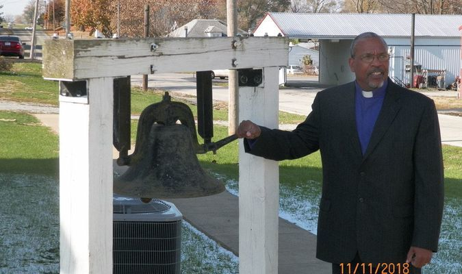 Reverend Robin Terrell rings the bell at the Second Christian Church DOC in New London on Sunday, November 11, at 11:00 a.m.  The bell tolled 21 times as a reminder of those Great War veterans and all veterans who served and sacrificed for our Nation.