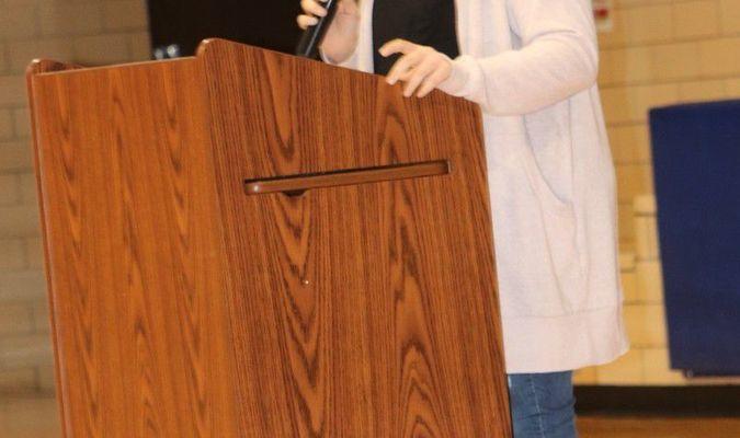 Bria Hooley, representing National Honor Society reads a poem at the Veterans Day assembly Monday, November 12, at Mark Twain High School.