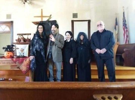 Members of the Musique Club Seniors performed as members of the Addams Family at the club's Annual Spooktacular.