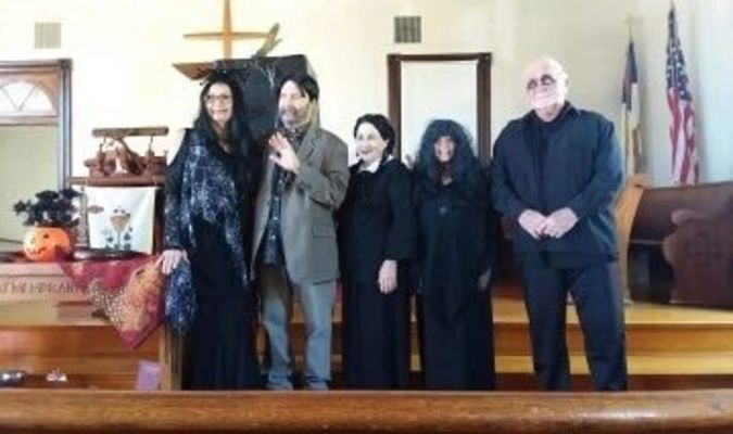 Members of the Musique Club Seniors performed as members of the Addams Family at the club's Annual Spooktacular.