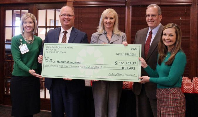 Pictured from left to right are Alicia Rollins, Director - Volunteer Services; Todd Ahrens, President & CEO - Hannibal Regional; Dr. Wendy Harrington, President & CEO - Hannibal Regional Foundation; Pat Benson, Chair - Hannibal Regional Board of Directors and Lydia Ahrens, President - Hannibal Regional Auxiliary.