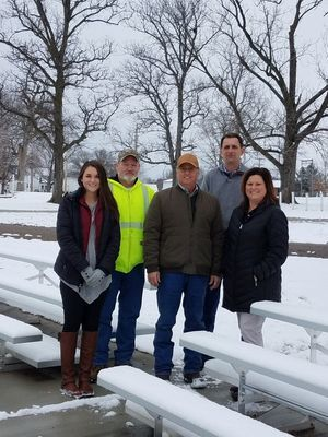 The new bleachers are in place and ready to use.  Pictured:  Devyn Campbell - Mark Twain Regional Council of Governments, Don Huff - Perry Utility Superintendent, Wiley Hibbard - Ralls County Presiding Commissioner, Chad Williams - Mayor of Perry, and Danette Henderson - Perry City Clerk.
