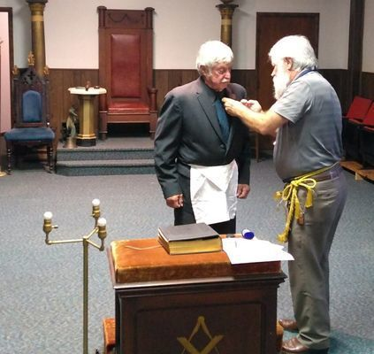 John Hawkins of Perry recently received his 50-year membership pin in the Ancient Free and Accepted Masons. Hawkins is currently a member of Lick Creek Lodge No. 302. Kenny Brundage, prior district deputy Grand Master, is pictured giving Hawkins his pin.