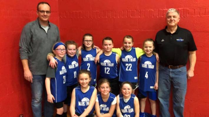 The 3rd grade girls team took 1st place in the Community League in overtime Saturday, February 23. Back row from left are Heath Eckler, Maggie Hicks, Jordan Wilkinson, Hannah Spradley, Chloe Hodges, Peyton Webber, Delanyea McMillen, and Dennis McMIllen. Kneeling in front are Jessen Engle, Emerson Eckler, and Erica Gilbert. Not pictured is Scott Hodges who was getting the girls' medals.