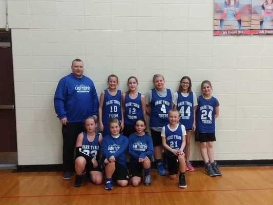 Mark Twain 5th grade girls are pictured back row from left Coach Eddie Landis, Marin Mallory, Delaney Moss, Lauren Haley, Ava Roberts, and Brooklyn Birkhead. Front row from left are Ella Moss, Maeley Moss, Sophia Landis, and Bella Hawkins.