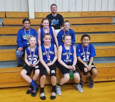 The Means Fifth Grade Girls finished in second place in the Community R-VI Youth Basketball League this year with a record of 8-2 for the season.  Pictured with their medals are:   Front row:  Lilly Martin, Lexi Preston, Randi Harris, and Maylie Boling.  Second row: Aryhanna Bridges, Adalynne Means, and Riley Dotson.  Back:  Coach Corey Means.