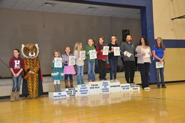 RCE February Habit Heroes:  Nola Kesler, McKinley Watkins, Zoey Clarkson, Delaynea McMillen, Brayden LaMar, Sophie Hicks, Coach Akright, Lara Daughtery, and Tara Lewis.  Pictured with the Habit Heroes are Sophia Landis and our Tiger Mascot, Maylie Boling.