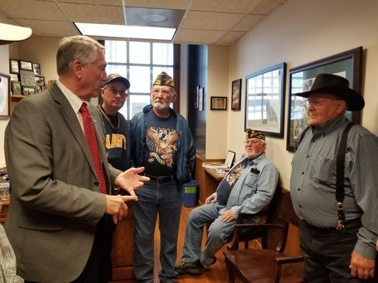 This picture was taken in Rep. Jim Hansen's office before Senate hearing on HB 1062 last week. Shown with Rep. Hansen are some of the VFW #4088 in Perry members, Bill Heim, Dan Carey, and Bill Wright. Dave Birch was one of many Ralls County landowners who attended the hearing.