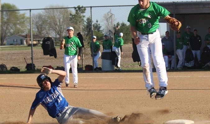 Parker Eddington #15 slides safely into third base under the feet of the Silex third baseman in the April 11 game against the Owls. The Tigers won 6-4.