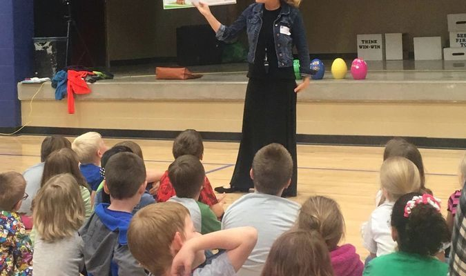 Destiny Schuenke, a local author, reads her book, Easter Eggsters, to Kindergarten, first and second graders at Ralls County Elementary. Schuenke's books are now being sold at Walmart, Kirlin's, Amazon, and Farm and Home.