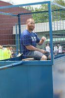 Coach Akright sits inthe dunking booth.