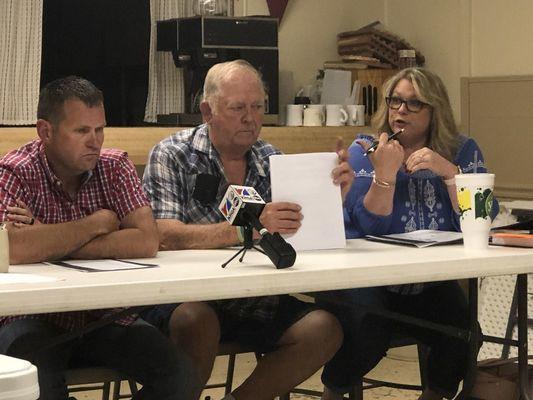 Aldermen Cristy Brown asks Attorney Joe Brannon a question after Brannon reads from State Statute 106.273 as Steven Reynolds and Tom Bramblett listen.
