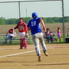 Grant Peters sprints for home in the game against Community R-VI. The Tigers won 8-3.