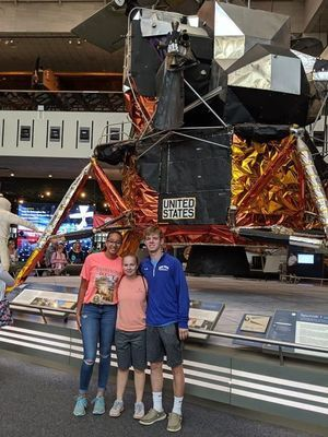 Kiona Austin, Lexi Baxter, and Preston Eckler are pictured in the Smithsonian.