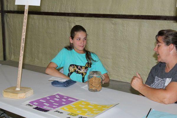 Liberty Wide Awake member, Brooklyn Birkhead, explains her project work to the judge.