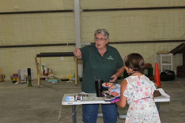 Nancy Harris, 4-H volunteer, directs exhibitors to their judges.