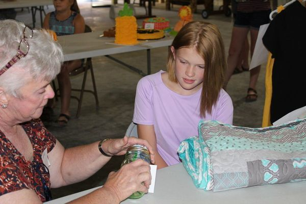 Adyson Caldwell, Liberty Wide Awake, listens as the judge checks out her quilt.