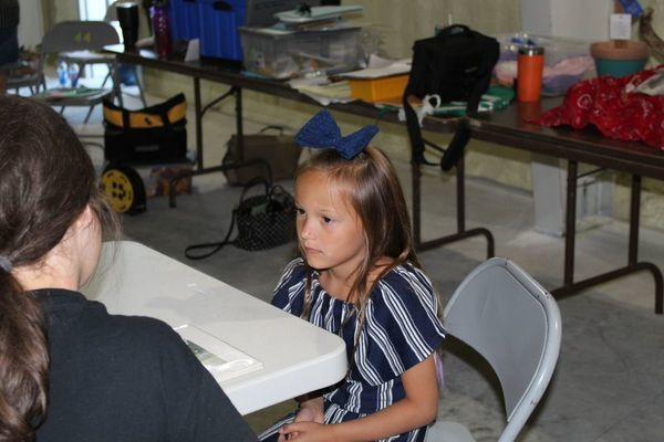 Clover Kid, Ayla Allee, member of Perry Pioneers, meets with the Clover Kids judge.