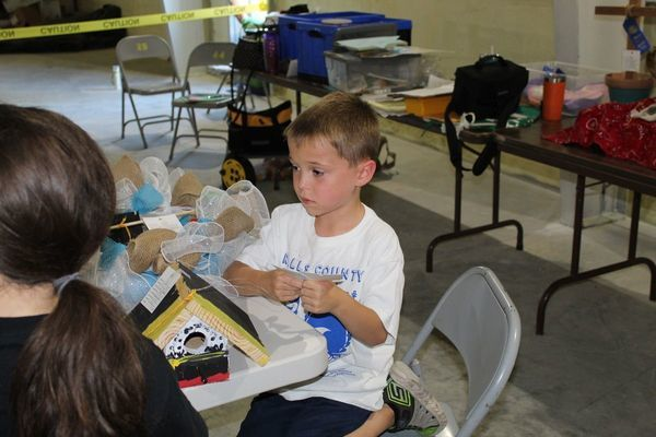 Clover Kid, Colton Reading, talks with the Clover Kid judge about his projects.