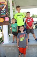 """Winners in the Frog Jump contest were back from left Alexander Breck Tucker (little brother); Azariah Tucker, 1st place with a 74"""" jump; and William Tucker, 3rd place with a 57"""" jump. In front is Alex Evans, 2nd place with a 62 ½"""" jump."""