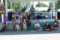 Pet Parade winners were from left Hailey Golian with Dorothy Mae, prettiest eyes; Ava McKinney with Lyla, shortest legs; Alex Evans with Max, most colorful; Marylu Jackson with Sugar, Best of Show; moral support for Sugar; Delaynea McMillen with Charlie, best dressed; Levi Coldiron with Dorothy Mae, longest hair; and Gracie Browning with Chickaletta, most unique.