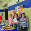 Ms. Kelsey Gervelier, elementary art teacher at Ralls County Elementary School, hosted an art show to highlight her art student's work  on April 21. Members of the Student Lighthouse Team served tea and cookies to the many visitors who came to view the artwork that adorned the hallways of the school.  Ryleigh Egbert, Mallory Daniels, Alyvia Paxton and Callie Reynolds helped serve the visitors.