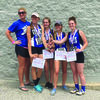 Coach Erin Mack is shown with the 4x8 relay team, Katie Neff, Kelsey Kendall, Maddy Ford, and Kenzie Lathrom with their medals for 8th place at the State Track Meet in Jefferson City on May 19.